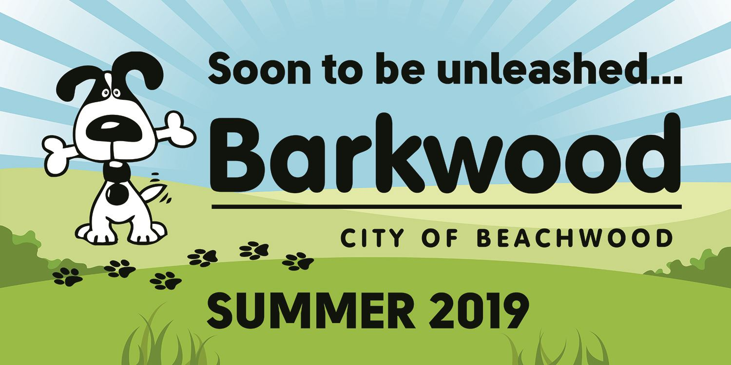 Barkwood Dog Park logo with a drawing of a happy black and white dog in a parklike setting
