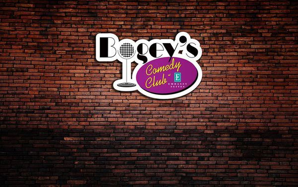 Brick Wall with a logo that says Bogey's Comedy Club