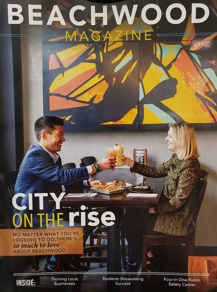 Cover of Beachwood Magazine: a lovely couple toasts each other at a Beachwood restaurant Opens in new window