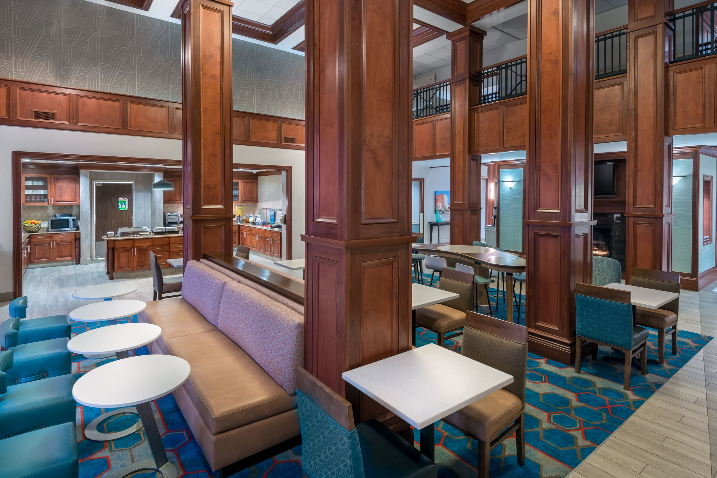 Breakfast area of Homewood Suites with tall wooden columns and striking decor